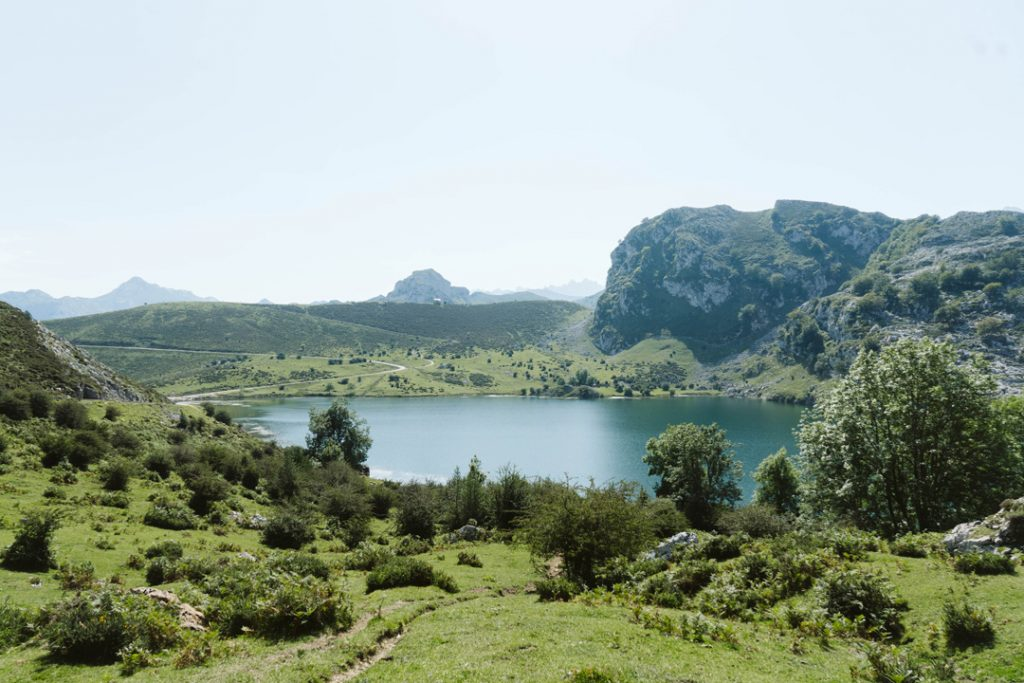 Green landscape of Cantabria, Spain with a lake and mountains in the background
