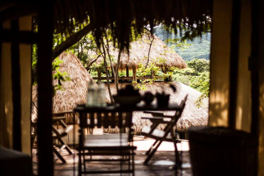 View of the Dinning area and jungle from on of the surf camp rooms